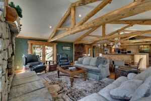02_Enjoy the open concept living areas and large fireplace encased in stone